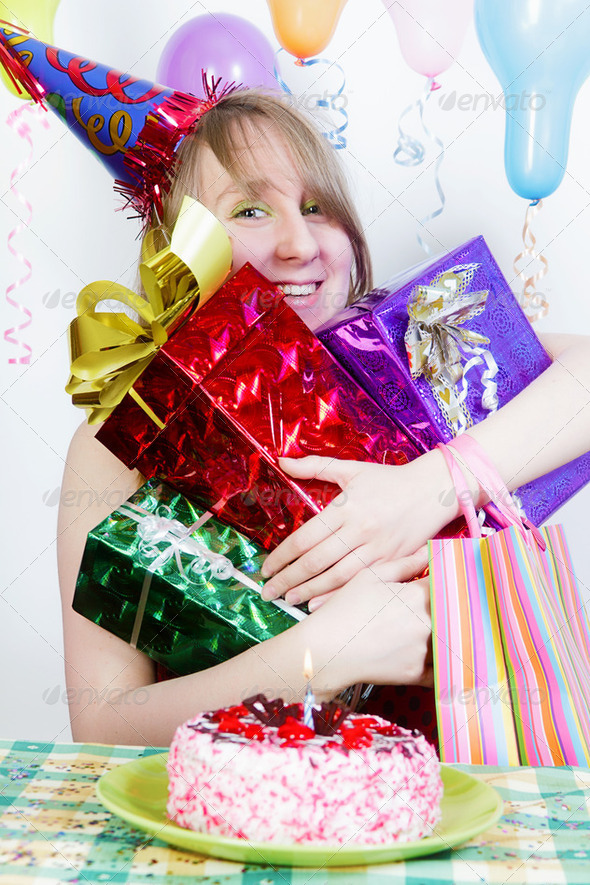 Birthday. Happy girl with gifts - Stock Photo - Images