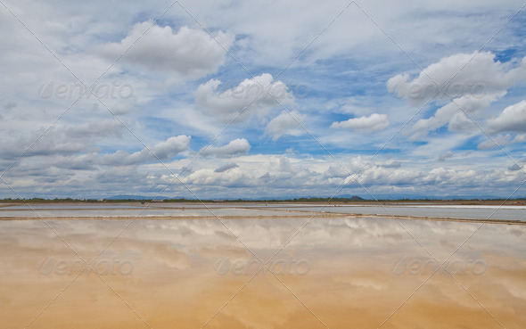 Reflection of sky on  salt farm - Stock Photo - Images