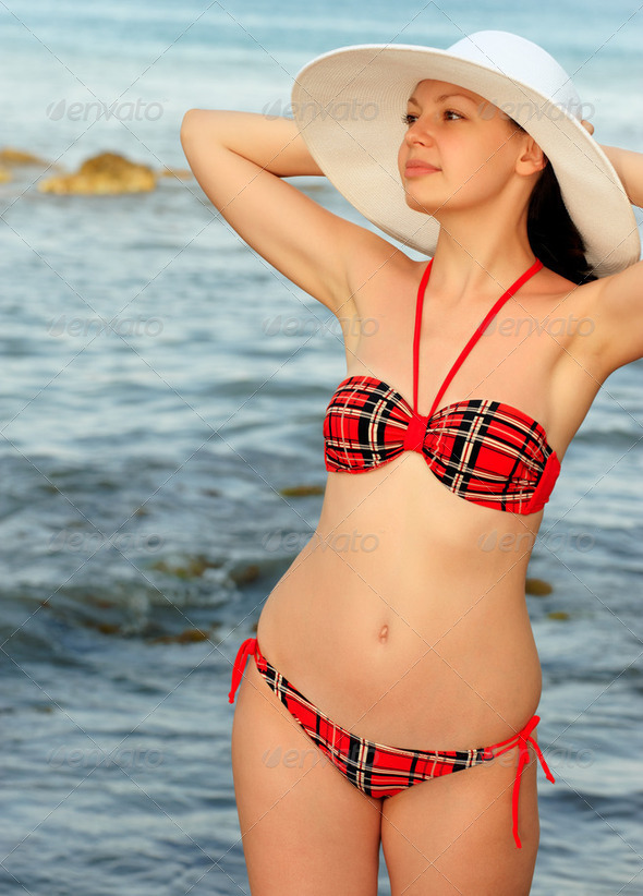 The girl in a hat against the sea - Stock Photo - Images