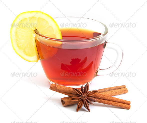 Cup of tea with lemon, anise star and cinnamon - Stock Photo - Images