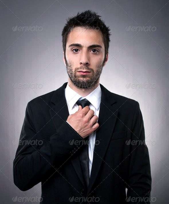 Young man in black suit - Stock Photo - Images