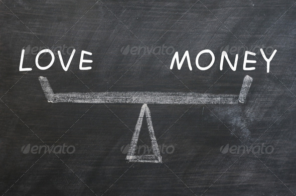 Balance of love and money drawn with chalk on a blackboard - Stock Photo - Images