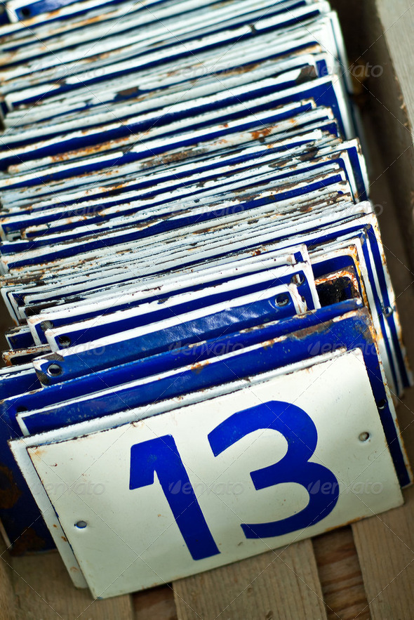 Enamel number plates with the number thirteen in front - Stock Photo - Images