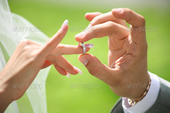 Exchange of wedding rings - Stock Photo - Images
