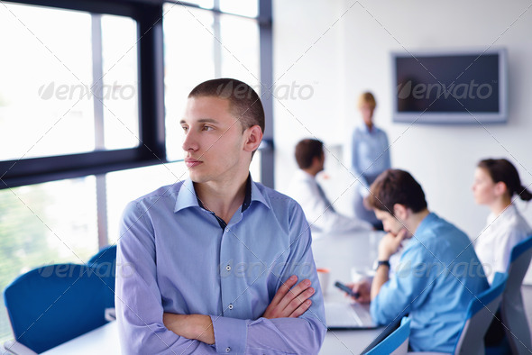 business man  on a meeting in offce with colleagues in backgroun - Stock Photo - Images