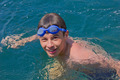 Teenager swims in the blue sea water - PhotoDune Item for Sale