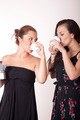 Two attractive women drinking coffee - PhotoDune Item for Sale