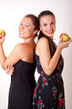 Two sexy happy women eating apple - PhotoDune Item for Sale