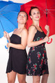 Two attractive women under red and blue umbrella - PhotoDune Item for Sale