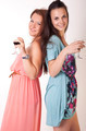 Two beautiful young girls drinking wine - PhotoDune Item for Sale
