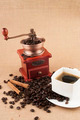 Coffee beans with cup and cinnamon sticks - PhotoDune Item for Sale