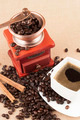 Coffee beans with cup and cinnamon sticks and coffee grinder - PhotoDune Item for Sale