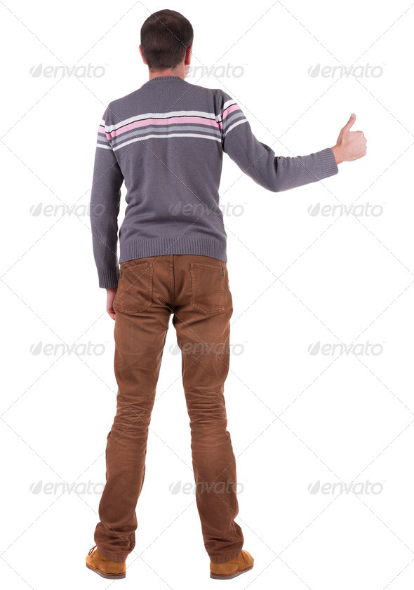 Back view of  man shows thumbs up. - Stock Photo - Images