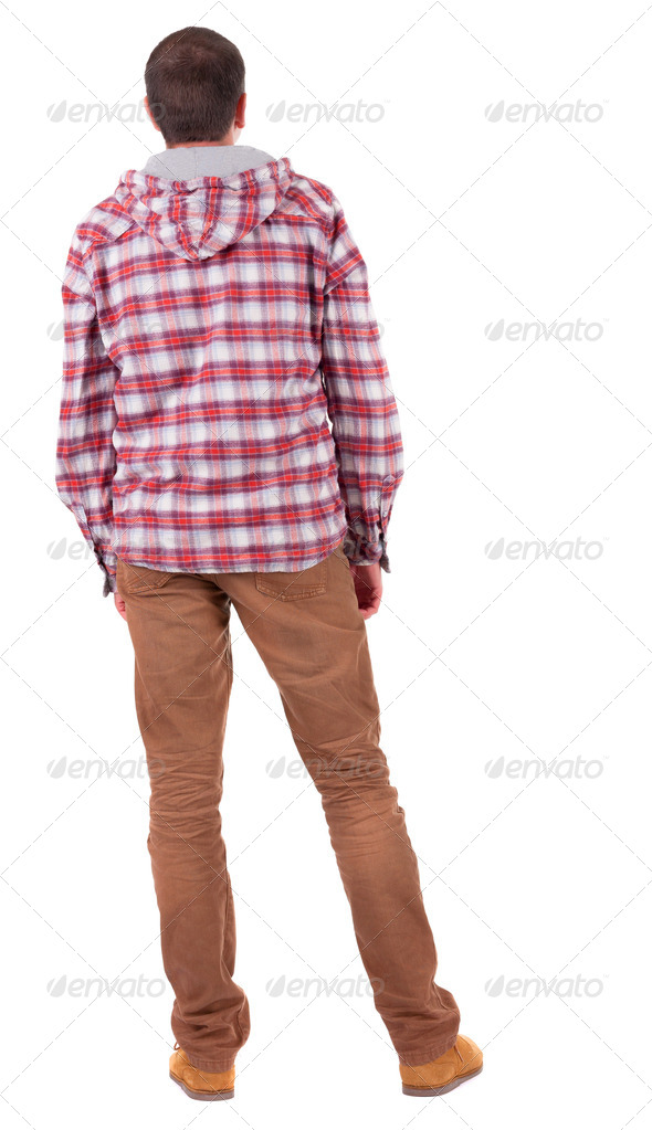 Back view of guy in a plaid shirt with hood  looking. - Stock Photo - Images