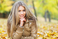 Smiling young woman in autumn - PhotoDune Item for Sale
