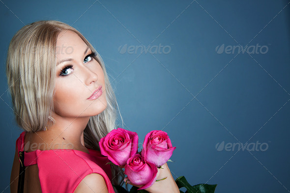 Blond girl with roses - Stock Photo - Images