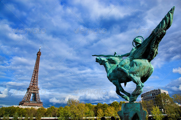 Eiffel Tower, Paris, Fance. Jeanne d'Arc statue - Stock Photo - Images