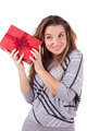 Young caucasian woman puting her ear to the present wrapped in r - PhotoDune Item for Sale