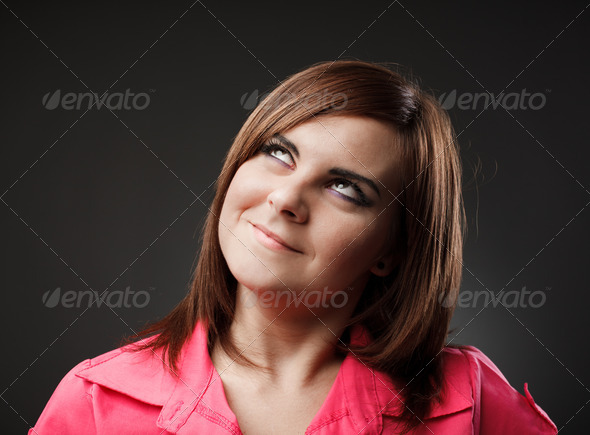 Young woman looking up - Stock Photo - Images