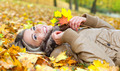 Young smiling woman lying on leaves in autumn - PhotoDune Item for Sale