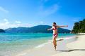 Woman running along tropical island beach - PhotoDune Item for Sale