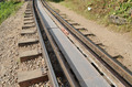 Horizontal closeup of railway lines in sunlight - PhotoDune Item for Sale