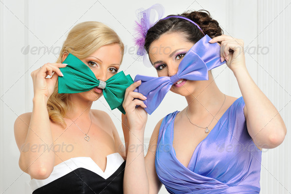Two beautiful woman in evening gowns having fun. - Stock Photo - Images