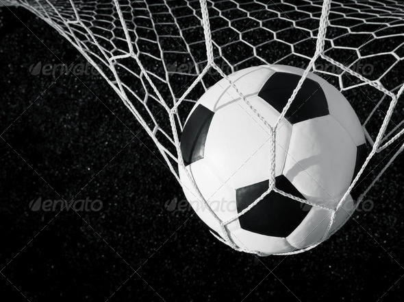 Soccer ball in goal, black and white - Stock Photo - Images