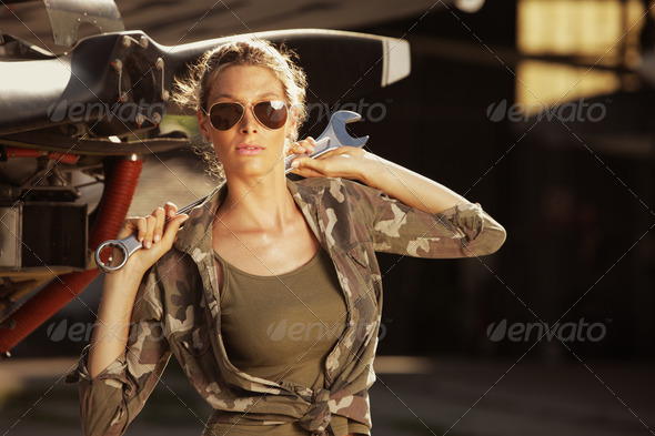 Fashion Female airplane mechanic - Stock Photo - Images