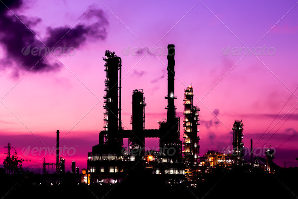 silhouette oil refinery plant and smoke at twilight morning - Stock Photo - Images