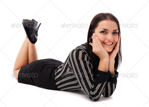 Happy businesswoman lying on the floor - Stock Photo - Images