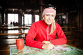 Woman hiker with map planning trip - PhotoDune Item for Sale