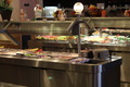 Buffet Table of Hot Food with Dessert Bar and Fresh Fruit - PhotoDune Item for Sale