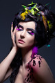 Fantasy. Fashion Female with Colorful Feathers - Bright Makeup - PhotoDune Item for Sale