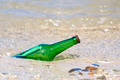 bottle with message on the beach - PhotoDune Item for Sale