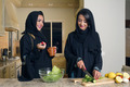 Two Arabian Women Cooking & Drinking coffee in the  Kitchen  - PhotoDune Item for Sale