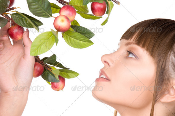lovely woman with apple twig - Stock Photo - Images