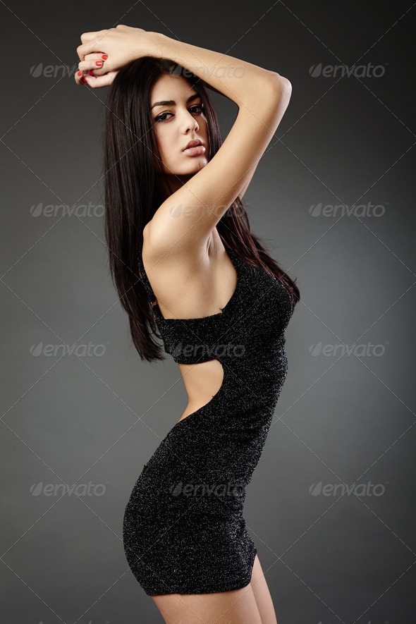 Gorgeous hispanic woman in black dress - Stock Photo - Images
