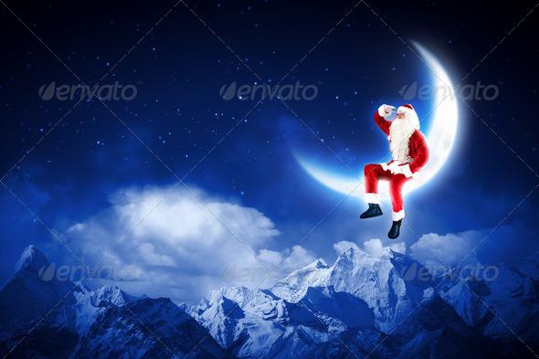 PhotoDune photo of santa claus sitting on the moon 3667991
