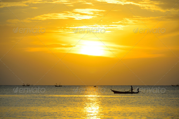 PhotoDune Silhouette fisherman are taking fishing boat 3689272