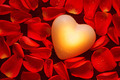 Glowing heart amongst red rose petals - PhotoDune Item for Sale