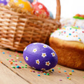 Easter decorations - eggs, cake and basket on the tabletop - PhotoDune Item for Sale