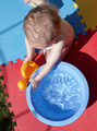 A young child playing with water - PhotoDune Item for Sale