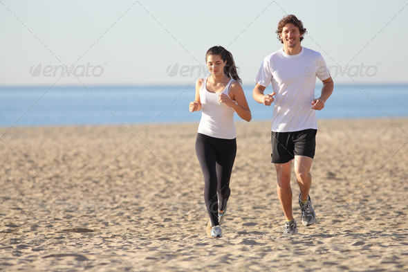 PhotoDune Man and woman running in the beach 3719910