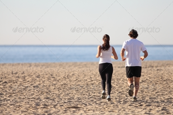 PhotoDune Man and woman running in the beach 3719911