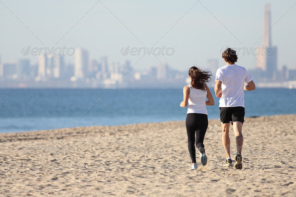 PhotoDune Man and woman running in the beach 3719913