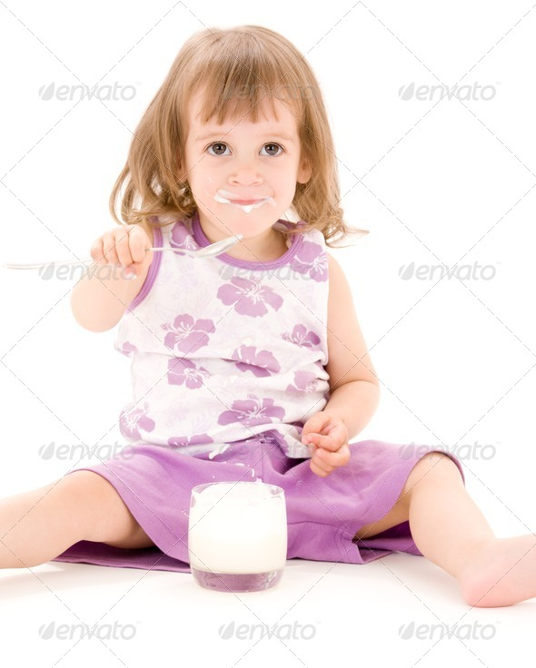 little girl with yoghurt - Stock Photo - Images