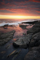 Sunset over rocky coastline - PhotoDune Item for Sale