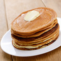 White plate with pankakes stack on the wooden table - PhotoDune Item for Sale