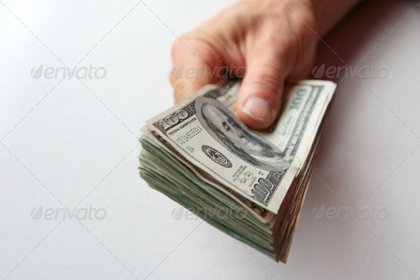man's hand with money - Stock Photo - Images